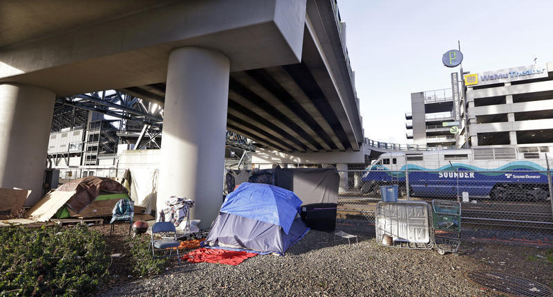 Tents sit under a Seattle overpass.