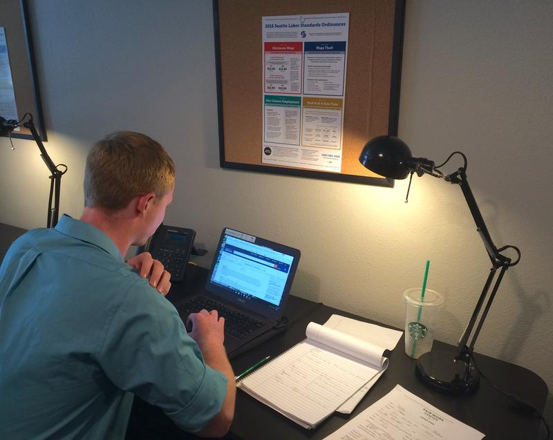 Seattle University law student Connor Smith researches employmetnt law at the Fair Work Center in Seattle, which runs the county's only legal clinic specializing in workplace issues.