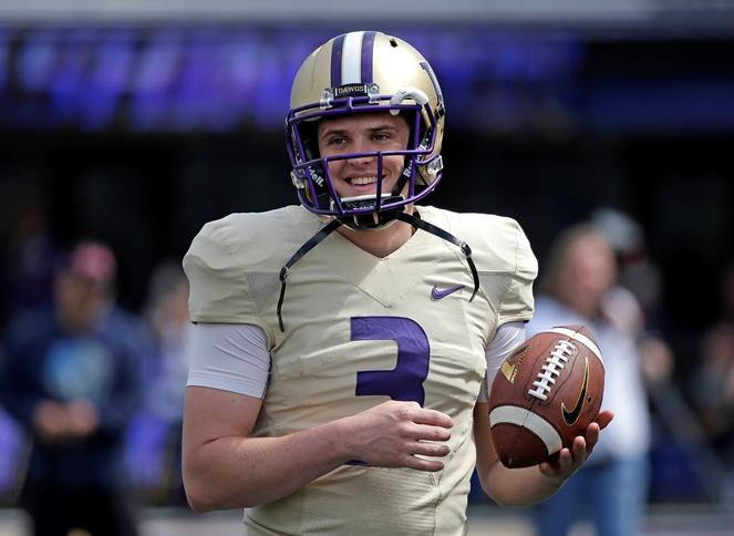 In this April 23, 2016, file photo, Washington quarterback Jake Browning smiles during a break at the team's annual spring college football preview event in Seattle. Browning is among four players to watch this season, according to commentator Art Thiel.