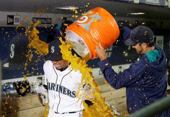 Mariners closing pitcher Edwin Diaz is doused by teammates after he earned his first save in the majors as the Mariners defeated the Red Sox 5-4, Tuesday, Aug. 2, 2016, in Seattle.