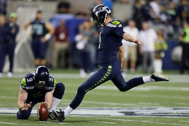 Seahawks kicker Steven Hauschka, right, kicks a field goal as Jon Ryan holds, in the second half of a preseason game against the Dallas Cowboys, Thursday, Aug. 25, 2016, in Seattle.
