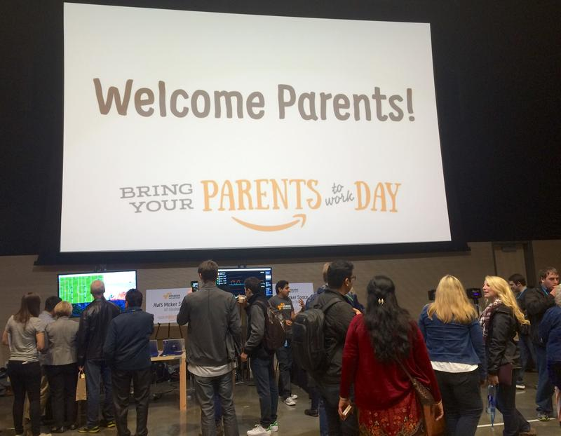 "Amazon employees and their parents explore a ""science fair"" at the company's first ever ""Bring Your Parents to Work"" day."