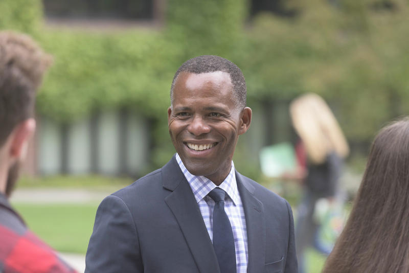 University of Puget Sound President Isiaah Crawford greets students as they arrive for a new year on the school's Tacoma campus. Crawford took office July 1.