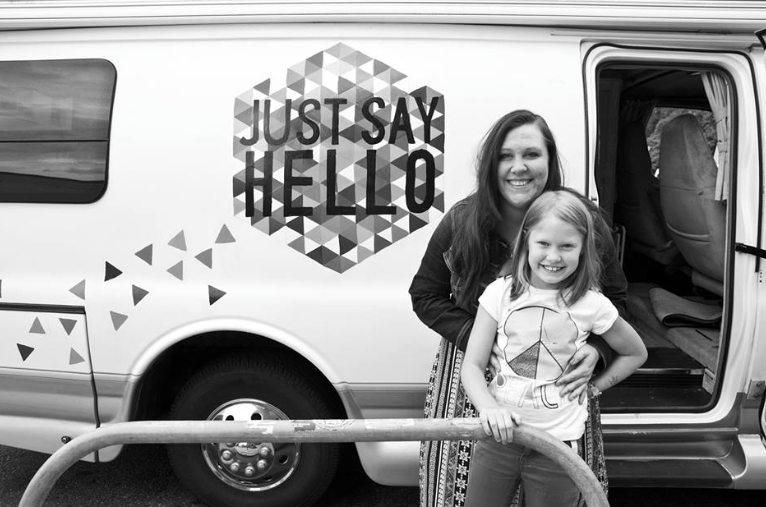 Jennifer Underwood and her daughter Rory, standing in front of their camper van.