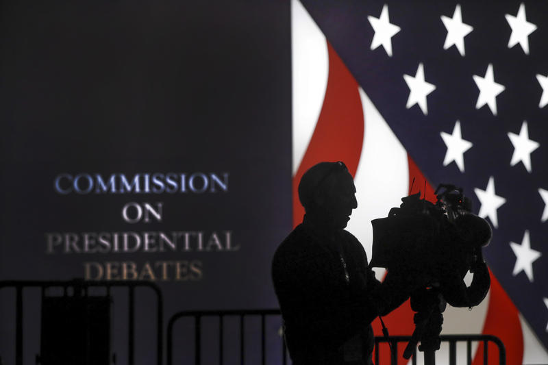 A videographer adjust his camera before the start the second presidential debate at Washington University in St. Louis, Sunday, Oct. 9, 2016.