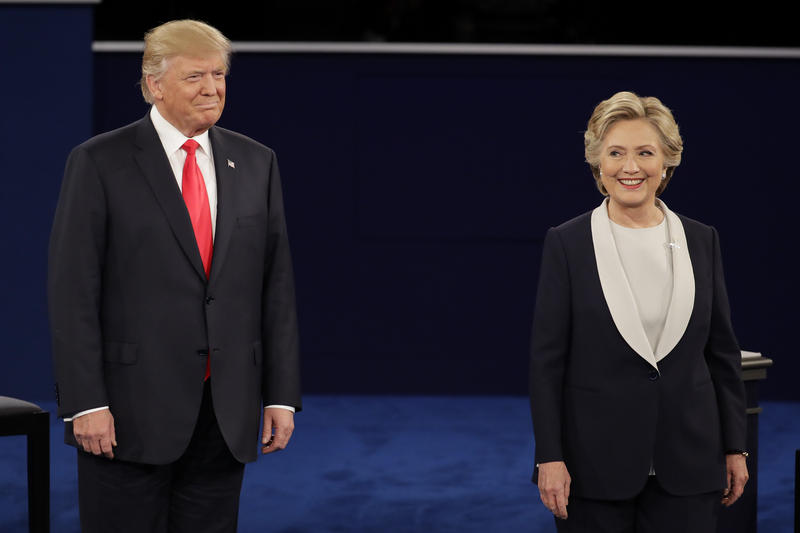 Republican presidential nominee Donald Trump stands next to Democratic presidential nominee Hillary Clinton during the second presidential debate at Washington University in St. Louis, Sunday, Oct. 9, 2016.