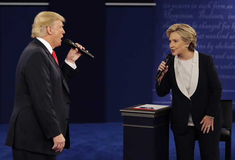 Republican presidential nominee Donald Trump and Democratic presidential nominee Hillary Clinton speak during the second presidential debate at Washington University in St. Louis, Sunday, Oct. 9, 2016.