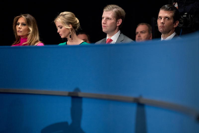 From left, Melania Trump, Ivanka Trump, Eric Trump, and Donald Trump, Jr., the family of Republican presidential candidate Donald Trump, sits in the audience before the start of the second presidential debate at Washington University, Sunday, Oct. 9, 2016