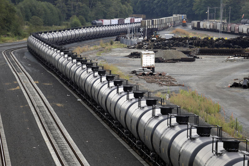 In this 2014 file photo, a northbound oil train sits idled on tracks, stopped by protesters in Everett. A hearing examiner in Skagit County said an oil-by-rail project at the Shell Puget Sound Refinery near Anacortes should get full environmental review.