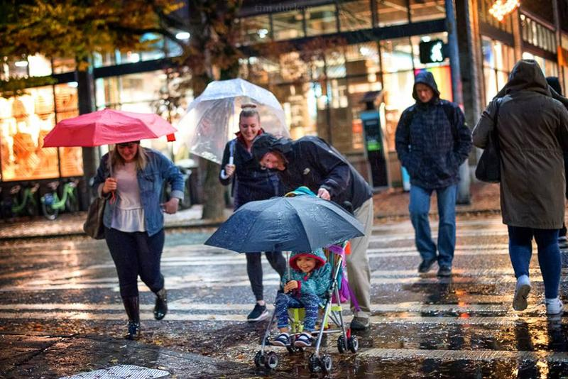Seattlites weathering the wet stuff on Monday. Record rainfall has hit the region in October, particularly in the two-week period from October 13-27.