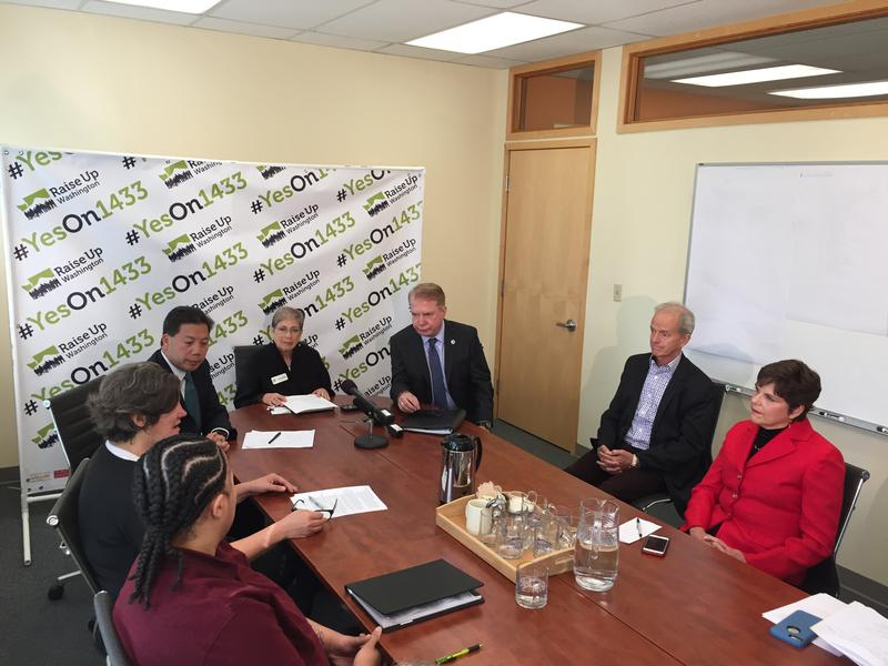 Supporters of Initiative 1433 hold a roundtable discussion in Seattle on Sept. 29. Participants included Seattle Mayor Ed Murray, Deputy U.S. Labor Secretary Chris Lu, and grocery worker Ariana Davis.