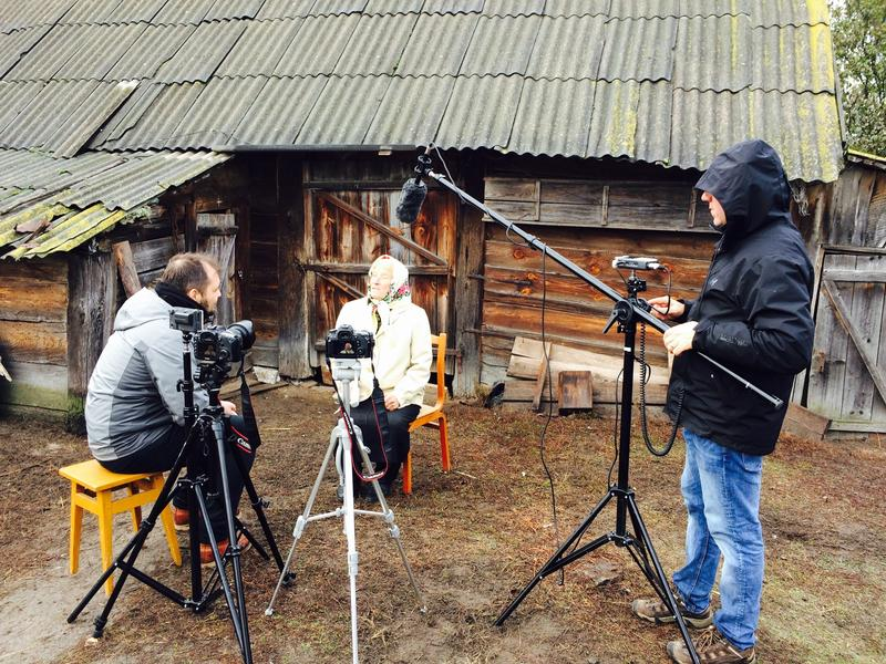"Veryovka (left) and Vesce (right) speak with a villager in western Ukraine, collecting video for the game ""The Forest Song"""