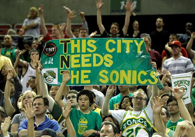 Fans cheer following a charity basketball game, Saturday, July 23, 2011, in Seattle. Since the Seattle SuperSonics were sold in 2008, fans have been trying to bring a NBA team back to the area.