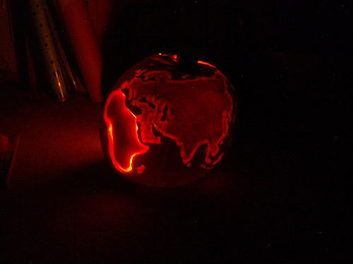 Africa, Europe and Asia carved into the side of a pumpkin. Halloween traditions common in the United States are catching on in other countries, says our travel expert.