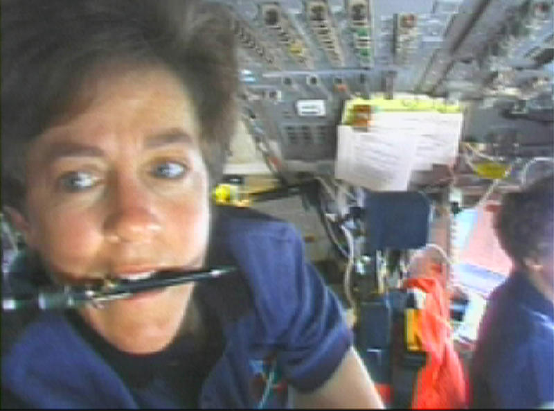 Astronaut Wendy Lawrence adjusts the television camera in this view from Discovery's flight deck Thursday, July 28, 2005.