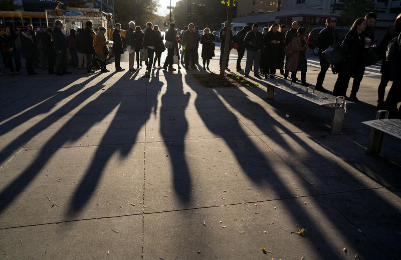 A line forms as people wait to vote on Election Day in the Upper West Side of Manhattan on Tuesday, Nov. 8, 2016, in New York.