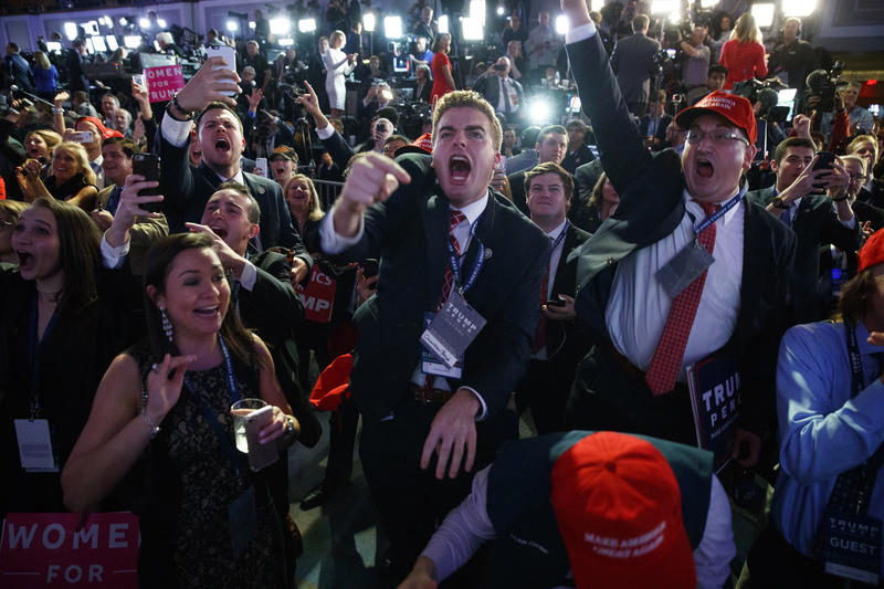 Supporters of Republican presidential candidate Donald Trump cheer as they watch election returns during an election night rally, Tuesday, Nov. 8, 2016, in New York.