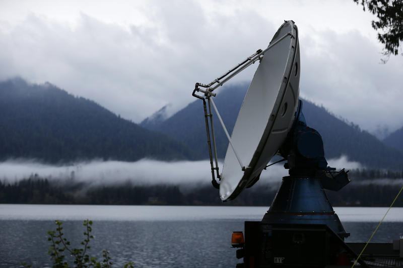 A truck-mounted radar instrument called the Doppler On Wheels scans cloudy skies Friday, Nov. 6, 2015, on the banks of Lake Quinault near Amanda Park, Wash.