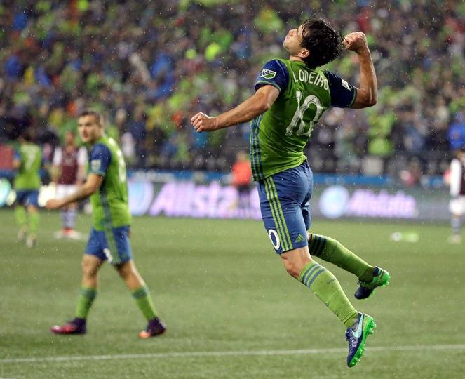 Sounders forward Nicolas Lodeiro, right, celebrates near forward Jordan Morris, left, after Lodeiro scored a goal against the Colorado in the first leg of the Western Conference championship, Nov. 22, 2016, in Seattle. The Sounders beat the Rapids 2-1.