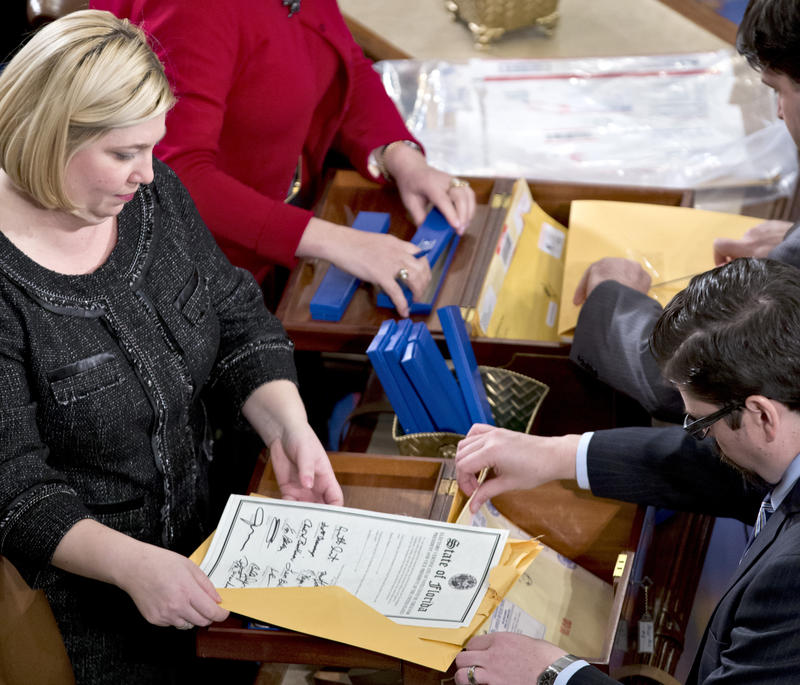 Clerks unseal the certificates of electoral results from all 50 states in January 2013, at the House of Representatives in Washington, D.C.