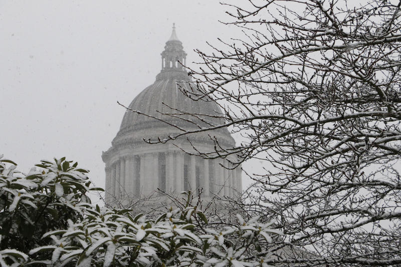 Snow is seen falling outside the Washington state Capitol on Thursday, Dec. 8, 2016 in Olympia, Wash. Other areas that saw snow in the Pacific Northwest included Vancouver, Wash. and Portland, Oregon.