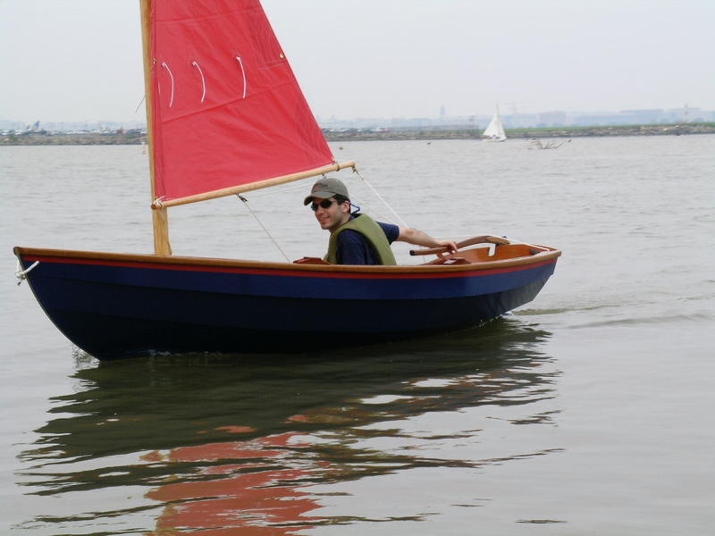 Colin sailing the Thistle Dew, a wooden dinghy he built and launched in 2004.