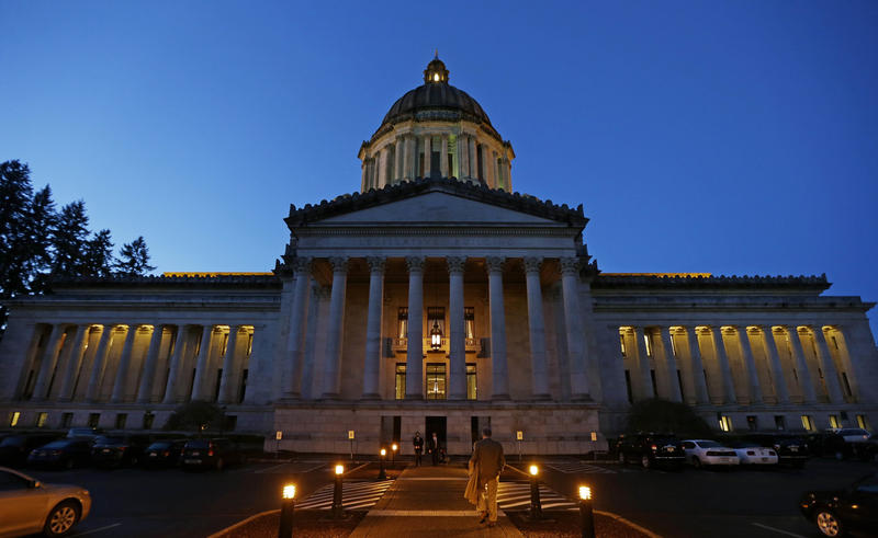 FILE - In this March 10, 2016, file photo, the Legislative Building is shown at dusk at the Capitol in Olympia, Wash.