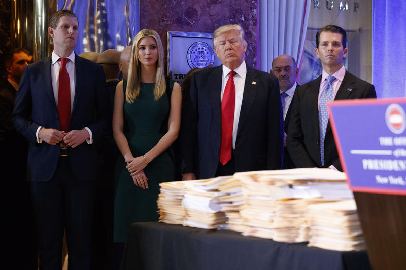President-elect Donald Trump, accompanied by his family, arrives a news conference in the lobby of Trump Tower in New York, Wednesday, Jan. 11, 2017.