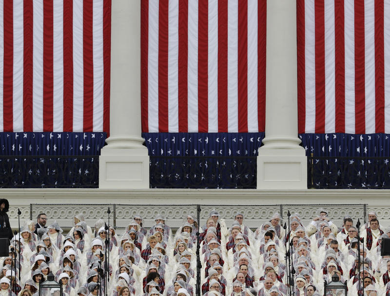 Members of the Mormon Tabernacle Choir wait for the swearing in of Donald Trump as the 45th president of the Untied States during the 58th Presidential Inauguration at the U.S. Capitol in Washington. Friday, Jan. 20, 2017