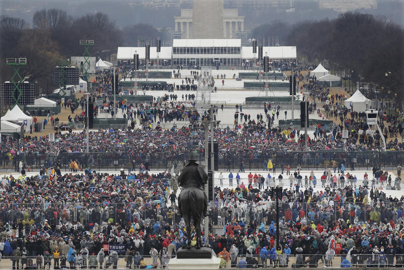 Crowds fill in along the National Mall before the swearing in of Donald Trump as the 45th president of the Untied States during the 58th Presidential Inauguration at the U.S. Capitol in Washington. Friday, Jan. 20, 2017.