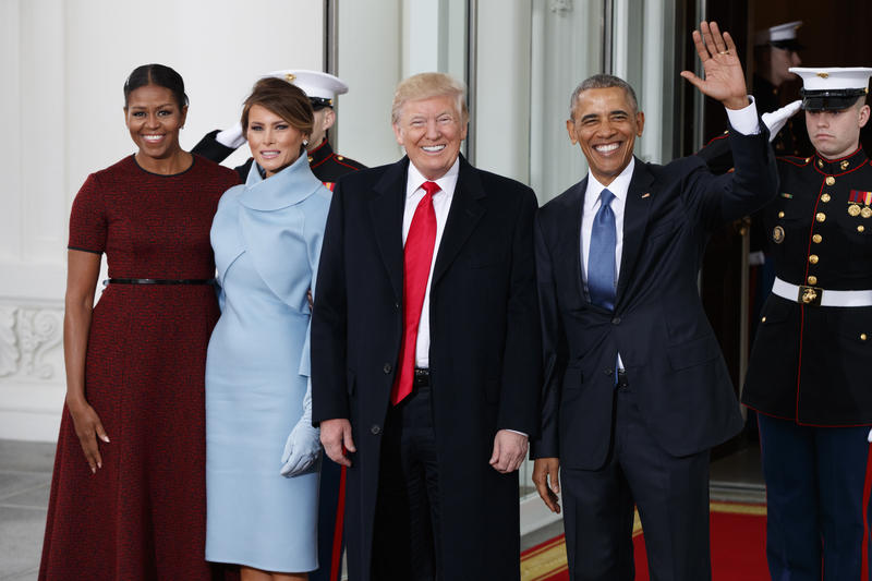 President Barack Obama and first lady Michelle Obama stand with President-elect Donald Trump and his wife Melania Trump at the White House, Friday, Jan. 20, 2017, in Washington.