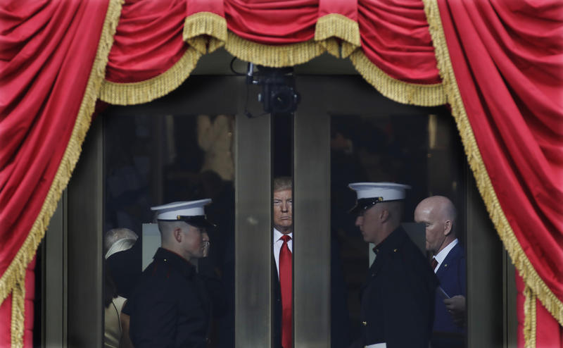 President-elect Donald Trump waits to stop out onto the portico for his Presidential Inauguration at the U.S. Capitol in Washington, Friday, Jan. 20, 2017.