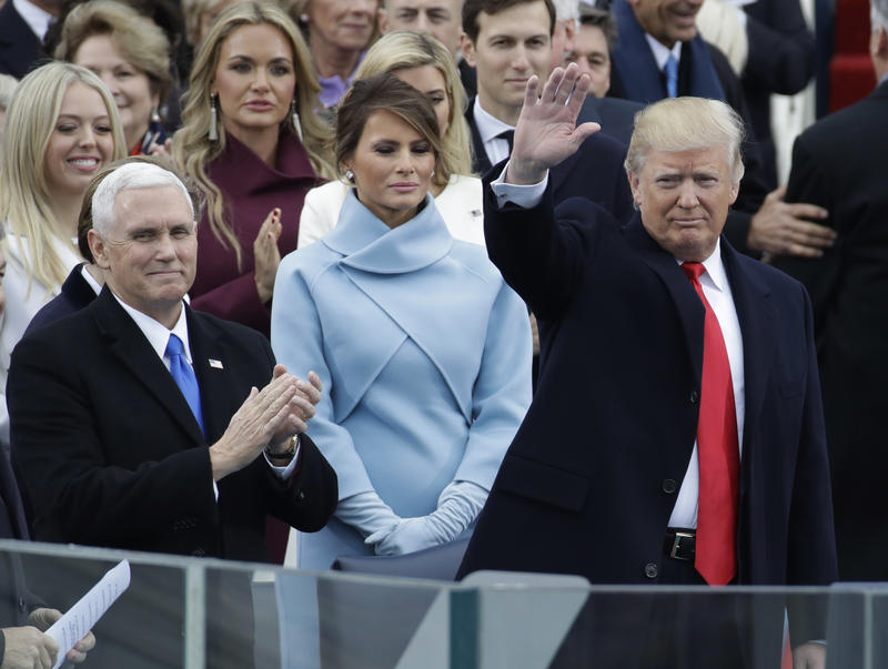 President-elect Donald Trump waves with Vice President-elect Mike Pence and his wife Melania Trump before the 58th Presidential Inauguration at the U.S. Capitol in Washington, Friday, Jan. 20, 2017.