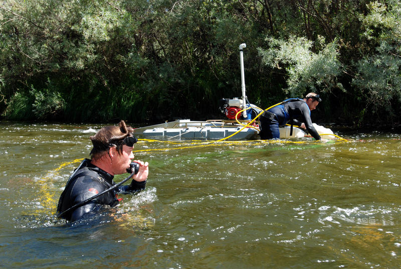 In this file photo from  2009,  Aaron Webb of Rapids, Wis., left, and Matt Lauer of Portage, Wis., team up to hunt for gold with a suction dredge on the Klamath River near Happy Camp, Calif.