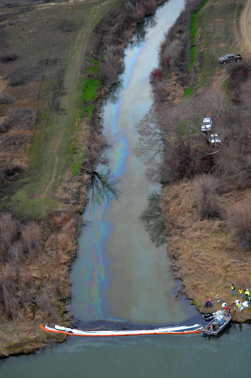 Boom tenders try to contain an oil spill on Sulphur Creek where it enters the Yakima River near Sunnyside, Wash. in March 2015.