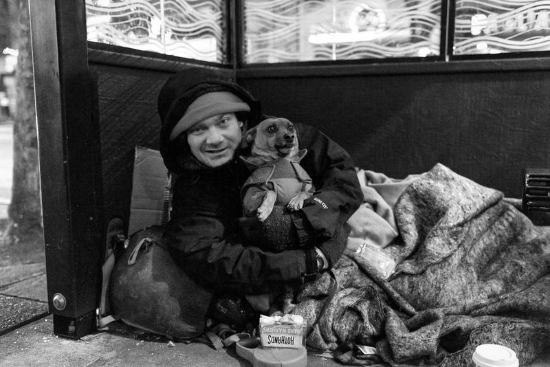Jessie and his dog Dexter, camped out in a bus shelter on Broadway in Seattle's Capitol Hill neighborhood.