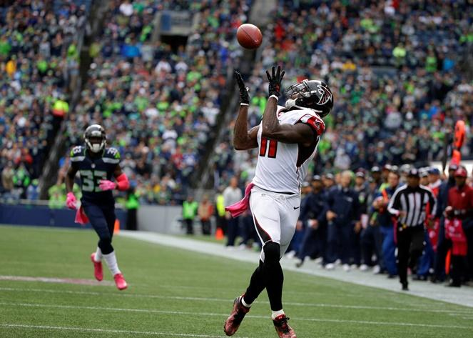 Atlanta Falcons wide receiver Julio Jones, right, makes a wide-open catch for a touchdown against the Seahawks in the second half of a game on Sunday, Oct. 16, 2016, in Seattle.
