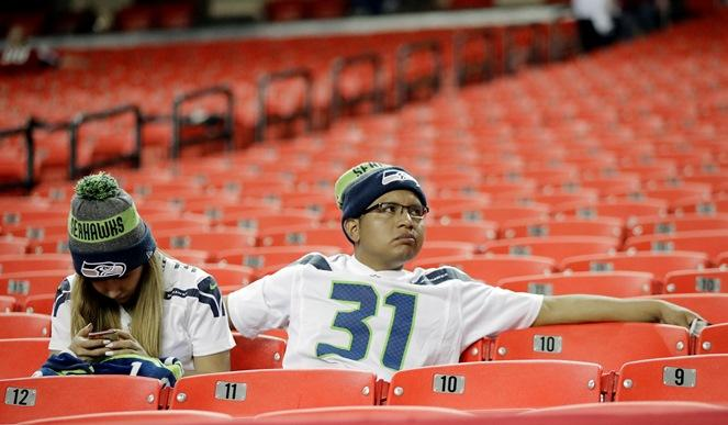 Seahawks fans sit in the stands after an the NFC divisional playoff game between the Seahawks and the Atlanta Falcons, Saturday, Jan. 14, 2017, in Atlanta. The Falcons won 36-20.