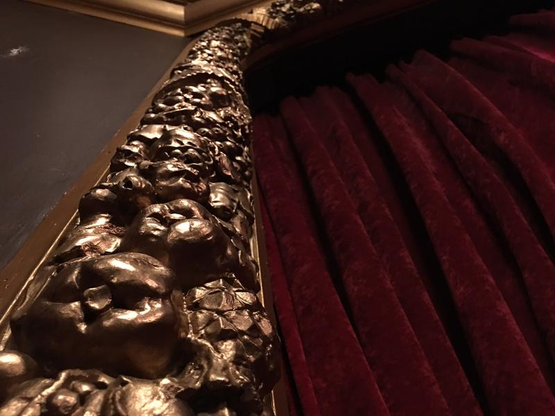 The proscenium, the archway that frames the stage at the Columbia City Theater in Seattle, is carved wood painted gold. It gets a fresh coat every year.