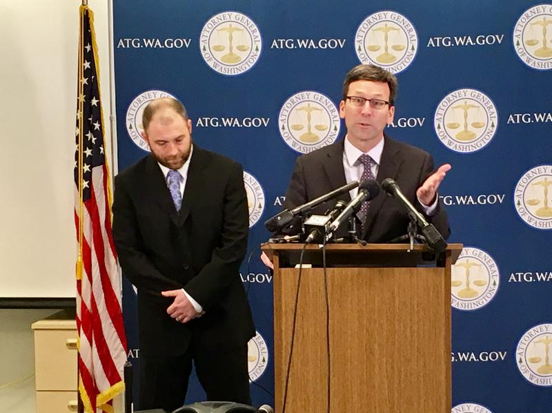 Washington state Attorney General Bob Ferguson with his co-counsel Ben Roesch as they announced the lawsuit against Navient from their Seattle offices on January 18th, 2017.