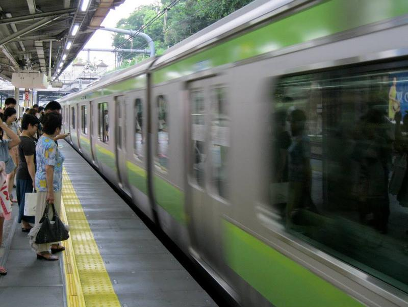 A train arrives to a platform in Japan on a hot summer day in 2013.