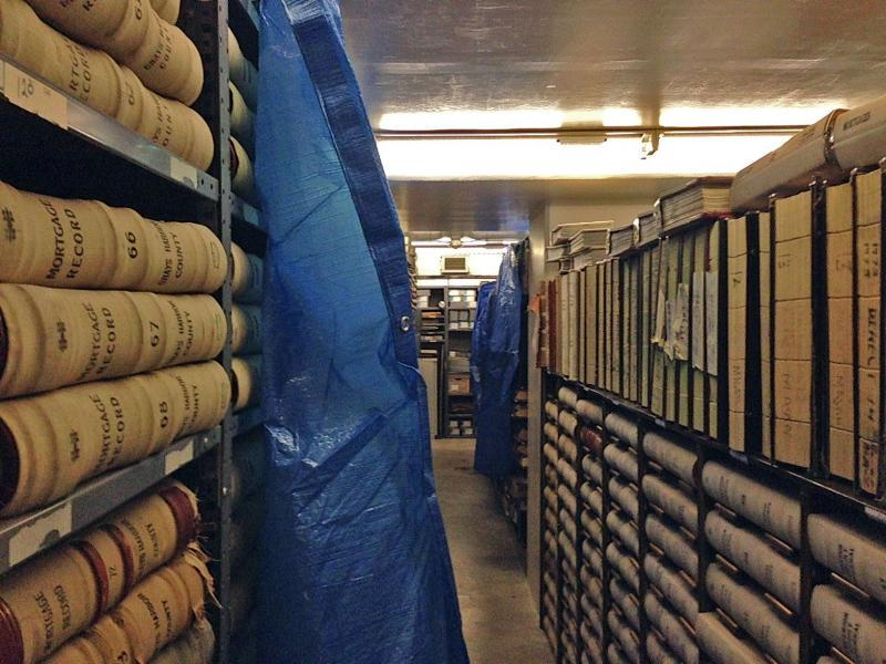Blue tarps protect historic records from flood waters dripping down from above at the Washington State Archives in Olympia in 2014.