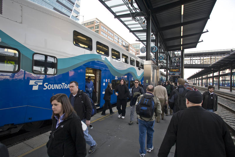 Commuters exit Sound Transit's Sounder train after it arrived in Seattle from Tacoma, Wash., on Thursday, April 3, 2008.