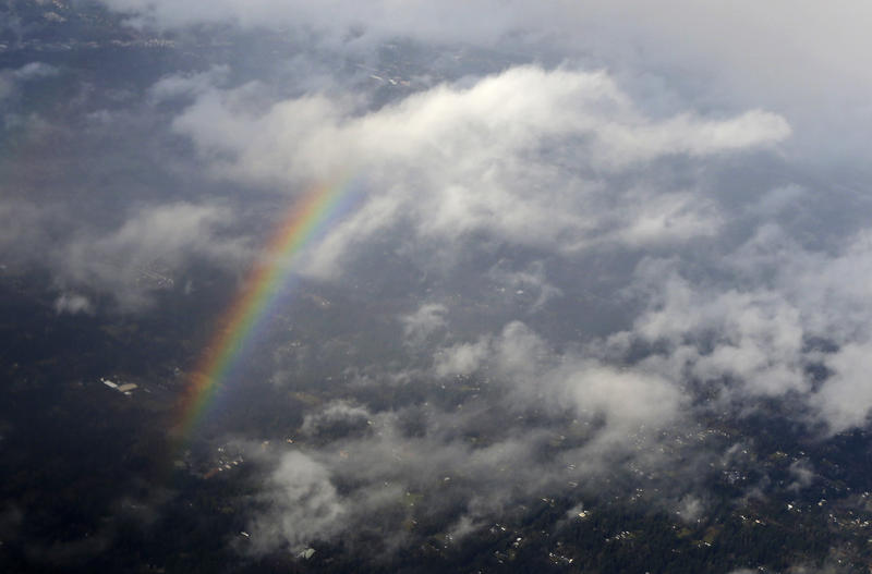 A rainbow is seen from the air, Thursday, Feb. 9, 2017, north of Seattle near Woodinville, Wash. Sun breaks and rain were the rule of the day for the Seattle area. More of that kind of weather is expected this weekend.