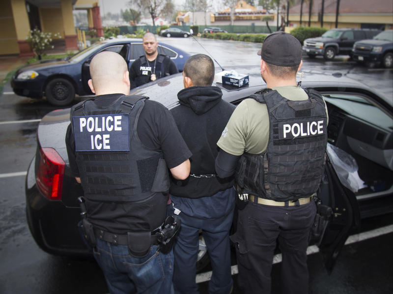 In this Tuesday, Feb. 7, 2017, photo released by U.S. Immigration and Customs Enforcement, foreign nationals are arrested during a targeted enforcement operation conducted by U.S. Immigration and Customs Enforcement (ICE)  in Los Angeles.