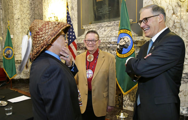 Brian Cladoosby, left, chairman of the Swinomish Indian Tribal Community, speaks witth Washington Gov. Jay Inslee, right, as Sen. John McCoy, D-Tulalip, center, a member of the Tulalip Tribes of Washington, looks on, Wednesday, Feb. 22, 2017.