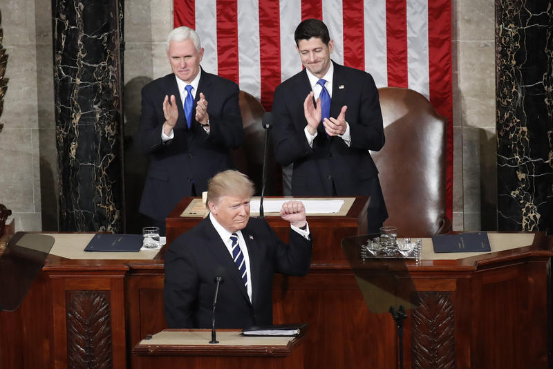 President Donald Trump, flanked by Vice President Mike Pence and House Speaker Paul Ryan of Wis., gestures on Capitol Hill in Washington, Tuesday, Feb. 28, 2017, before his address to a joint session of Congress.