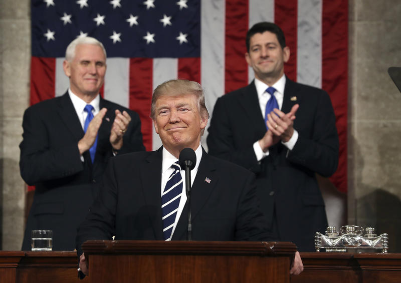 President Donald Trump, flanked by Vice President Mike Pence and House Speaker Paul Ryan of Wis., arrives on Capitol Hill in Washington, Tuesday, Feb. 28, 2017, for his address to a joint session of Congress.