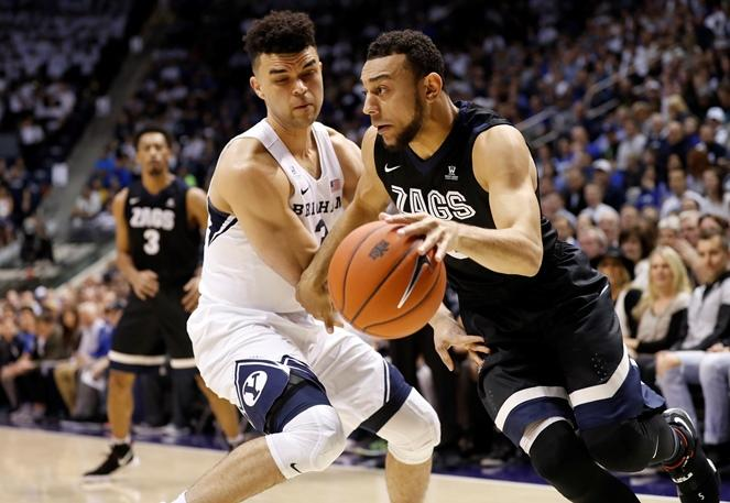 Gonzaga guard Nigel Williams-Goss (5) dribbles past BYU guard Elijah Bryant (3) during the first half of an NCAA college basketball game Thursday, Feb. 2, 2017, in Provo, Utah.