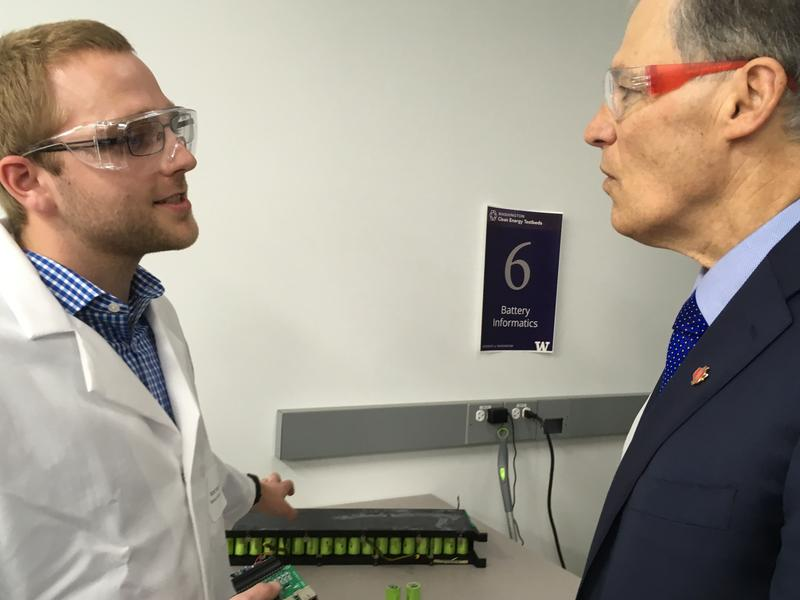 Matt Murbach (left) co-founder of Battery Informatics, explains the company's power management device to Governor Jay Inslee on an opening day tour of the Washington Clean Energy Testbeds, Feb. 16th, 2017.